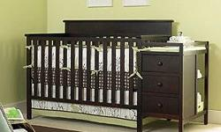 Never used Lauren crib and Changing table Color espresso Also have brand new mattress and frame for when it turns into a toddler bed.
