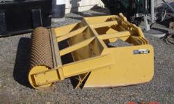 """Rollerlevel 84"""" John Deere patent. Large expanded covered full width roller out front to crush clods. The box is like a skip loader scraper turned backwards for a skidsteer.This is a factory built uni"""