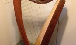 This Triplett Catalina Harp is 56 inches tall, weighing 25 lbs. It has 34 strings, from C2-A7. It has Camac levers, a spruce and Cedar Composite Soundboard for a large sound, with maple binding. It co