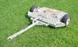 GreensWagon - transport your walk behind greens mowers. Mower locks up and off the deck of the GreensWagon. Drum, height adjustment roller, and bedknife are protected against damage. Perforated deck f