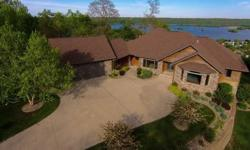 Beautiful panoramic views of the town of Guttenberg and the Mississippi River can be seen from this 5,700 square foot home, built in 2007, on 6.68 acres with 6 bedrooms, 4 full baths and an 848 SF 3 c