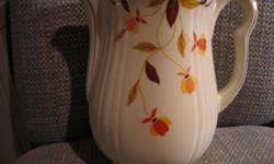 Autumn Leaf Jewel Tea Coffee Pot. No lid. Excellent condition. No chips, cracks, or crazing. Measures; 8.5 inches tall by 9 inches at the widest.