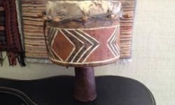 Be the envy of your drum circle with this hand carved painted wood drum with natural conceal head. Has a deep tone. No concept of origins ... might be African ... might be the Bronx, but it's a cool p