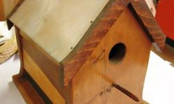 "Handmade by Woodworking HobbyistWood Birdhouse with Tin Roof Measurements are 10.5"" Base x 10"" at Peak x 6.5"" wideHelp house a bird family through the winter with this sturdy pine house with a strong"