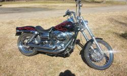 This 2007 Dyna Wide Glide only has 5052 miles on it s a 96 cubic inch 6 speed transmission , Its a nice bike but does have one small dent in the tank won't take much to fix . Runs great shifts good. G