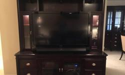 """Haverty's living room set for sale: entertainment center (pictured with 52"""" tv in photo) and matching end tables. It is made from real wood and entertainment center has interior touch lighting. Contac"""