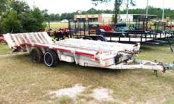 Heavy Duty Equipment hauler trailer, long slant fold down back for easy loading, skid steer, scissor lifts or small fork lifts.$1695.00 Bill of Sale Only 912-427-7062 912-269-9349 Location: Jesup GA