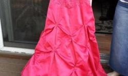 Beautiful hot pink satin prom or formal dress size 3. The brand is Blondie Nights. Elegant dress had filigree style bead work on body and bust. Lovely diamond tucking with bead work is on the skirt po