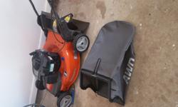 Essentially new mower. Bought at Lowes on 14 Apr 15 for $360, used twice for total of three hours. Clean, no scratches, runs perfectly. Comes with bagger and clippings deflector attachments. 6.25 HP m
