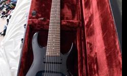 Black 8-string Ibanez with locking nut and EMG pick-ups.Rarely been played, though owned for years.Needs to be re-stringed, and does not have a hex key for the locking nut.Will sell case with guitar f