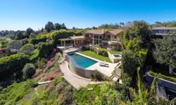 """""""A Rare Opportunity"""" on the front row of the Riviera Country Club, this trophy gem offers panoramic views from the Country Club to the Pacific Ocean. Sited on 50 yard line of prestigious Napoli Drive"""