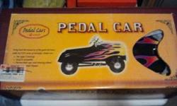 NEW IN BOX (IT'S THE iCARLY PEDAL CAR) NEW AT TOYS R US 149.99 THIS ONE IS HEAVY (ASSUMING ALL METAL) BUT NEVER HAD IT OUT OF BOX FIRST 100 BUCKS TAKES IT!!! PLEASE CALL OR TEXT 785-213-5204 (LEAVE ME