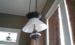 """This lamp is often referred to as a IRON HORSE hanging lamp. It has a 14"""" slant shade and period milk glass. Great for entryway, foyer any home with high ceilings. Nothing broken or scratched. Convert"""