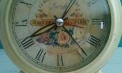 "Beautiful alarm clock. Replica of Antique. Works great!5 1/2 "" x 5 1/2"" height/width"