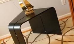 Part sculpture, part table. The curved shape of the wood Bentwood Table takes its motivation from vintage Danish furnishings.  Functional with a one of a kind design-this piece offers a distinct way t