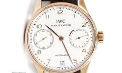 Pre-Owned IWC Portuguese 7-Day (IW500113) self-winding automatic watch, features a 42mm 18k rose gold case surrounding a silver dial on a brown crocodile strap with an 18k rose gold deployment buckle. Functions include hours, minutes, small-seconds, date,