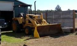 John Deere 210 c Loader tractor $8,500 runs good 229-237-5355 Location: adel ga