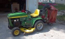 "John Deere 212 with 46-48"" mowing deck,deck is in fair shape but does not turn free,engine cranks over with good compression but has no spark engine is a k321AQS Cast iron Kohler,the yard vac engine t"