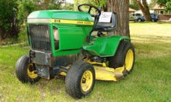 """1978 John Deere 316 riding lawn tractor: Kohler engine runs strong, recent tune up & blade sharpening, new big battery, hydraulic cutting deck, hydraulic fittings in front for possible snow blower/bl"