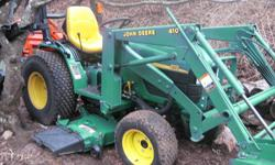 """CREAM PUFF OF A JOHN DEERE MODEL 4110 COMPACT TRACTOR, 4X4, 2 SPEED HYDROSTATIC TRANSMISSION, YANMAR DIESEL ENGINE. DIFF. LOCK, FRONT LOADER AND 7 IRON 54"""" MID-MOWERDECK. 540 REAR PTO, AND CAT 1 3PT H"""
