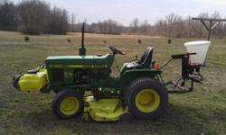 """John Deere 650 tractor in excellent shape! 16hp 2 cylinder diesel. 60"""" mid-mount mower. Attachments included are a 5' blade for 3 point hitch and a 53"""" offsetable rotary tiller. Blade and tiller are o"""
