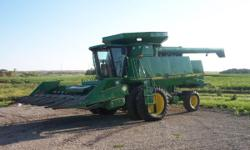 1996 John Deere 9600 combine equiped with duals, Green Star yield and moisture monitor, grain tank extensions, and chaff spreader. 2002 John Deere 930F flex head with AHHC and in very good condition,