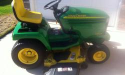 """2005 John Deere GX335 garden tractor. Features a 20hp air cooled Kawasaki engine. Larger 54"""" Convertible mowing deck. Fully loaded with power steering, hydraulic deck lift, and differential lock. Has"""