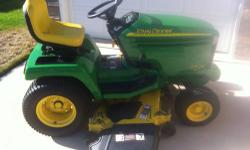 "2005 John Deere GX335 garden tractor. Features a 20hp liquid cooled Kawasaki engine. Larger 54"" Convertible mowing deck. Fully loaded with power steering and hydraulic deck lift. Comes equipped with 4"