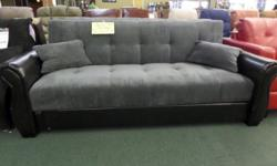 This brand-new futon sleeper sofa from Serta is as functional as it is awesome! Features grey microfiber upholstery with black synthetic leather arms and base with 2 relatively easy to fix toss cushio