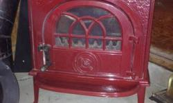 I have a Jotul American Fireplace Stove # 8 in Red Porcelain enamel. Red is no more offered as they only made them for a specific amount of time. It has the stack that will ventilate through the roofi
