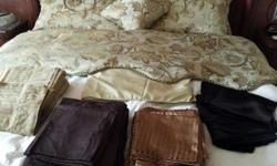 Type: Bedding King /Comforter,skirt,2 shams,1decor pillow $30.00 King sheets 4 sets $45.00 2 Cotton, gold,brown 2 Satin,bronze stripe,black Sheets will coordinate with comforter. Buy cokforter set and