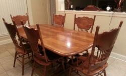 Table with 4 chairs, bar chairs, and china cabinet. All in good condition. Selling at best price offered.