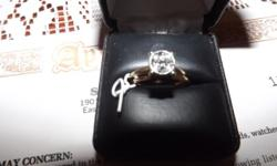 Estate sale, 1948 14 karat yellow gold, set consisting of a band and engagement ring. The band is 1.7 millimeters. The engagement ring has a round diamond of 1/3 carat, which is set in a square illusi