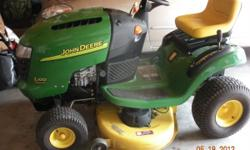 """John Deere L100-42"""" lawn tractor, gear-driven...17 hp 5 Briggs & Stratton Industrial/Commercial engine...5-speed gear drive...42"""" cut...runs like new...Has brand new blades , new battery, newly adjust"""