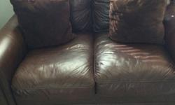 Leather couch and couch for sale. $700.00 OBO. They are brown and extra-large. The seating part is the size of a twin size bed. Removable cushions and simple to move. This set has six down filled sued
