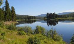Escape to your very own piece of NW Montana paradise! Get away from it all at your own Island Lake Escape! 29+ rolling acres with over 1,600 feet of Island Lake frontage. Enjoy nature at its best whil