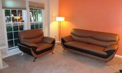 Sofa and chair- bonded leather material as seen at Z furniture-excellent condition.We Seek a change of style only. Furniture now only $600 cash. . If this is your style choice now-its a great set. 2 y