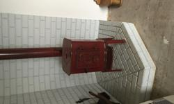 This is a llange wood stove made in demark. It is red in colorand made out of cast iron. This is in excellent shape. Red incolor. Please call or text 907 254-XXXX