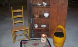 Here is a lot of antiques. A real nice old blue cupboard with shelves, a ladder back rocker, a lamp made from an old brass torch with new country shade, an old plaster dog from the 50s, yellow wooden