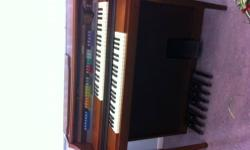 LOWREY CELEBRATION LX-500 MINT CONDITION, ELECTRONICS PERFECT. HAS SOLO AND ORCHESTRAL VOICES, ANIMATION, FULL RANGE POWERFUL SOUND SYSTEM, HARMONY PLUS RHYTHM PLUS ORCHESTRATION. CHERRY WOOD CABINETR