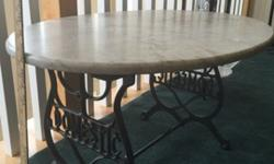 """Grey marble, oval coffee table on antique sewing machine stand, 34"""" x 25"""" x 18""""h, Excellent condition: $85Grey marble, 3 tier end table, 12"""" dia x 26""""h, Excellent condition: $25Buy both: $100 total"""