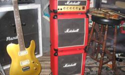 "I have a Marshall Lead 12 Mini Stack: 15w solid state head, 2 Speaker cabs w/1-10"" per cab.  This amp is in great condition and no rips or tears.  It as well is Red tolex covered.  Great little amp."