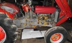 1963 Massey Ferguson 35 4 cylinder continental gas engine with a hi/low transmission. Tin is fairly straight one fender is somewhat smashed but was straightened. Needs a good sandblasting and painting