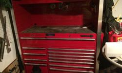 Matco tool box with side shelf and cover. In excellent condition,ball bearing drawers,grease fittings on the wheels. Top drawer stretches across the box with 7 medium drawers and 4 small drawers. Paid