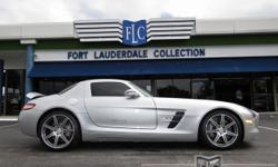 This 2012 Mercedes-Benz SLS AMG 2dr 2dr Coupe SLS AMG features a 6.2L 8 CYLINDER 8cyl Gasoline engine. It is equipped with a 7 Speed Automatic transmission. The vehicle is Iridium Silver Metallic with
