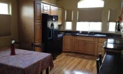 Great Snowbird/Winter Visitor Home.This is a 2009 Santa Fe Gold Deluxe model with tons of upgrades. Laminate wood floor throughout. 850 sq ft. Front load washer/dryer. Cellular top up/bottom down shad