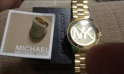 I'm a female that enjoys to put on a guy's big face MK watch with my MK dinner ring that occurs to match perfectly! I bought both from Dillard's 7mos ago for a total of $600 and will compromise a loss