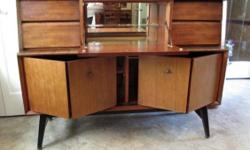 See all my Options at: www.antiquebirdies.comI mported from London, Fabulous and Definitely Special Mid Century Modern Sideboard Buffet, Credenza, Lobby or Collectibles Cupboard. This Walnut Veneered
