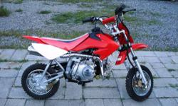 Mini-Bike 110cc Electric Start, 4 Spd Manual Clutch (new never used) This is a 2004 model year reproduction of the popular Honda CRF 70. This is a modern dirt-bike, using mono-shock technology. This b