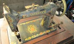 Antique Minnesota (Sears) sewing machine. Cabinet is in reasonable condition. Sewing device shows some rust. The belt from the treadle is missing and I have actually not tried a repair. Possible resto